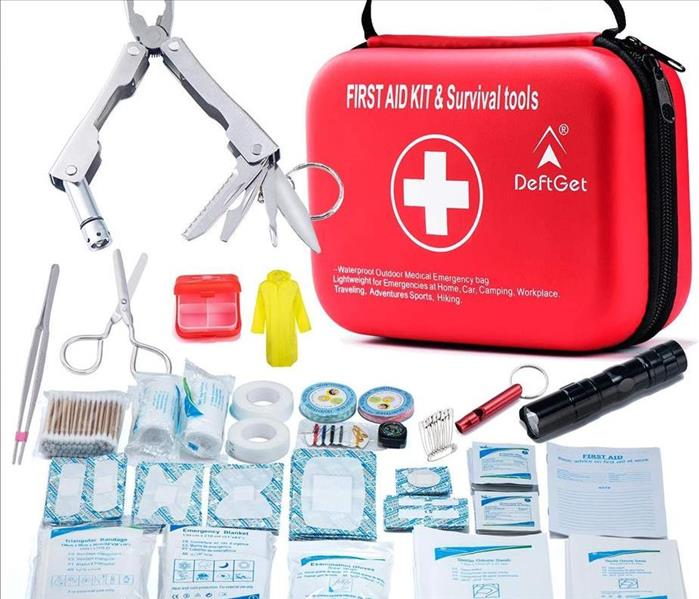 First Aid Kit with bandages, wraps, tweezers, scissors.